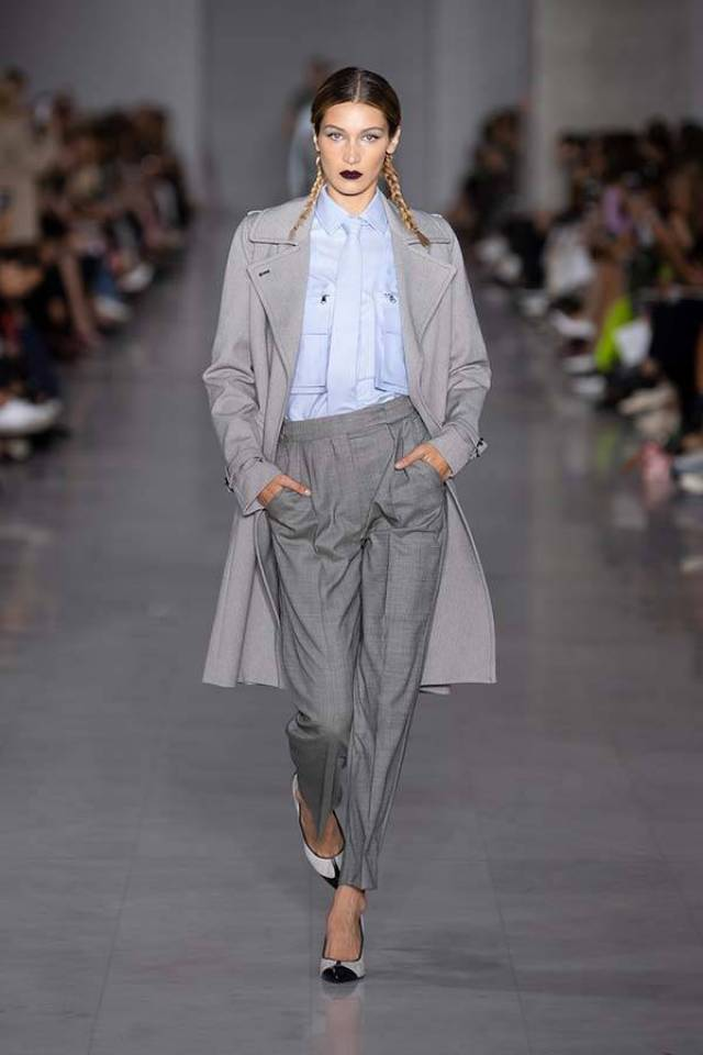 The collection includes monochrome three-piece suits with Bermuda shorts and pipe pants, elongated shirts, ties, knee-high socks and satin slip-dress