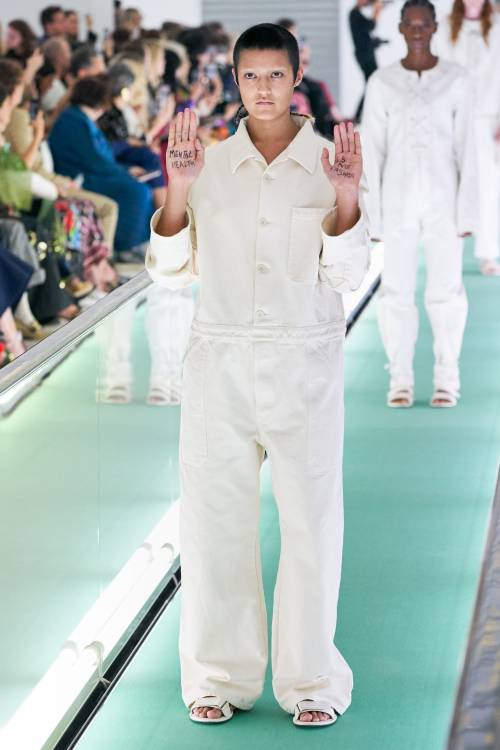 "Model Ayesha Tan-Jones with ""Mental health is Not Fashion"" sign on her palms"