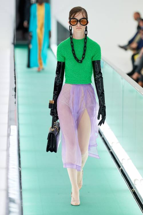 The saturated green wool vest and the transparent violet skirt in a color-blocking technique