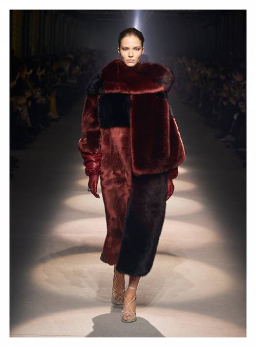 Faux fur coats in dark velvet and pastel caramel with black align with the enigmatic subtext of the collection