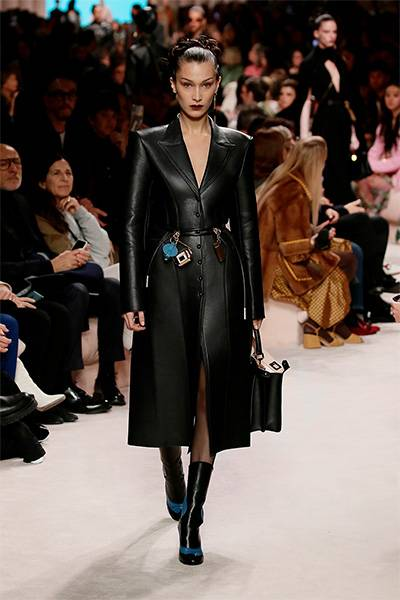 A slim-fitted leather coat in the style of a vamp woman